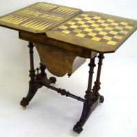 Victorian burr walnut and marquetry inlaid games/work table Hammer: £1,250