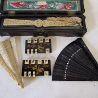 A pair of Japanese lacquered and gilt decorated markers and carved ivory fan. Hammer £3100