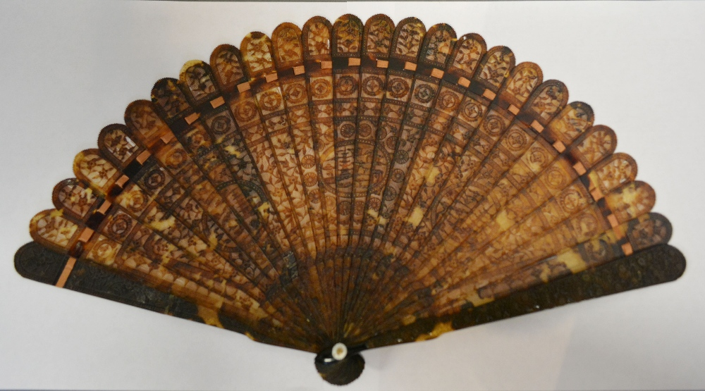 A Late 18th or Early 19th Century Chinese Tortoiseshell Brise (Hu Shan) Fan with intricate and delicately carved wafer thin sticks depicting three cartouches and inscribed 'Guards', 20 cms long Hammer: £1,550