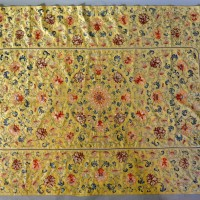 An Early Chinese Silk Work Embroidered Panel with foliate scrolls upon a yellow ground,  171 cm by 110 cm Hammer £4,000