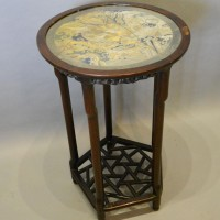 An Early 19th Century Chinese Hardwood Occasional Table a circular top with silk work panel above a pierced frieze, raised upon five turned legs with fret work under tier Hammer £7,500