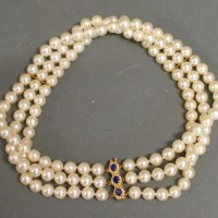 A Triple Row Cultured Pearl Choker With A Triple Sapphire and Diamond cluster clasp in gold Hammer £620